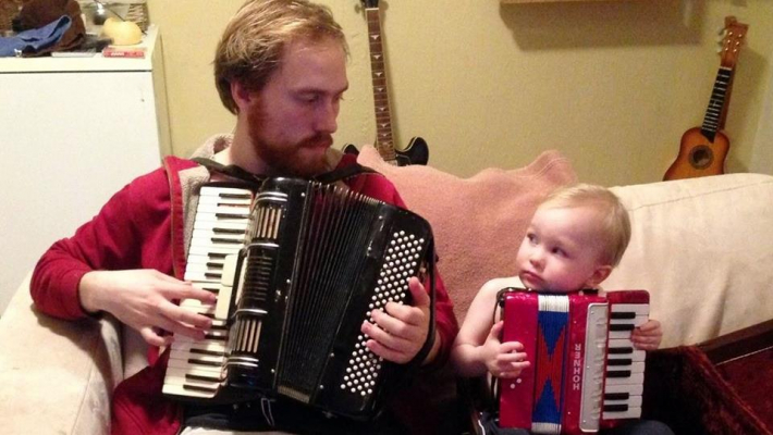 Linus Orri and his young son play accordions.